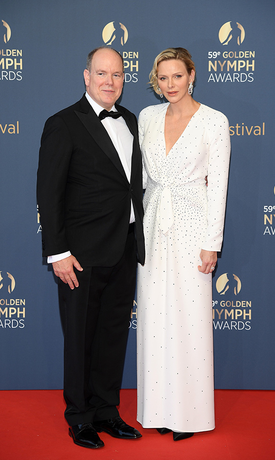 "<a href=""/tags/0/prince-albert""><strong>Prince Albert II</strong></a> and <a href=""/tags/0/princess-charlene""><strong>Princess Charlene</strong></a> of Monaco made a dapper duo at the closing ceremony of the 59th Monte Carlo TV Festival. Albert looked handsome in a tuxedo, while his wife dazzled in a white low cut gown.