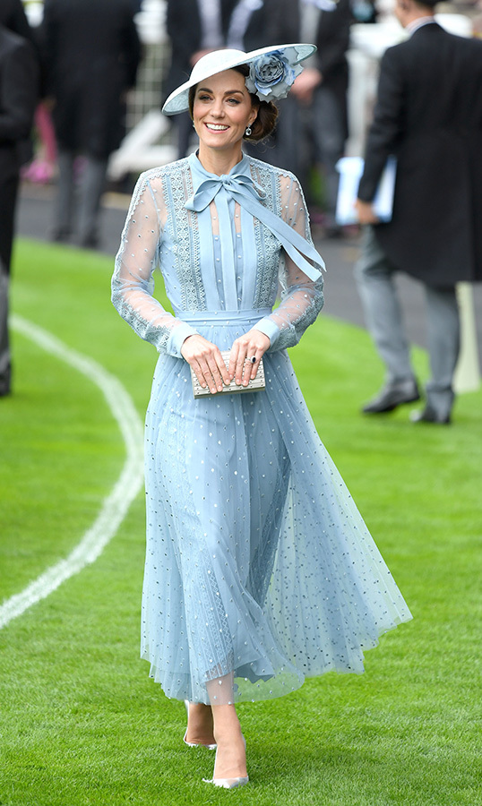 "<a href=""/tags/0/kate-middleton""><strong>Duchess Kate</strong></a> glided across the freshly mowed Ascot grass in an ethereal blue Elie Saab gown with the perfect modern topper. The number, crafted by the Lebanese fashion designer, boasted a sweet pussy bow around the neck and sheer arms. As for accessories, Kate chose a pair of seemingly new metallic pumps and a matching small clutch.