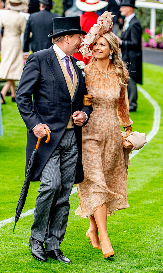 "Hats off to <a href=""/tags/0/queen-maxima""><strong>Queen Máxima</strong></a> yet again! The Argentinian queen wore a beautiful peach dress and extravagant floral topper for day one of Royal Ascot. She anchored the look with brown suede pumps, carrying a beige scarf and wearing matching gloves. Her husband, King Willem-Alexander, looked handsome in a morning coat and top hat. 