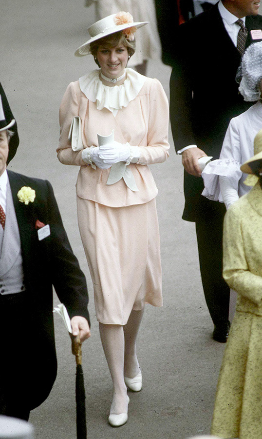 For her third and final day at the 1981 races, Lady Diana closed it out with a fashion bang! The then 19-year-old went with a pale peach skirt and blouse number, boasting a chic white frill around the neck. She jazzed her outfit up with a three-strand pearl necklace, anchoring the look with white shoes, perfectly matching her crisp white accessories.