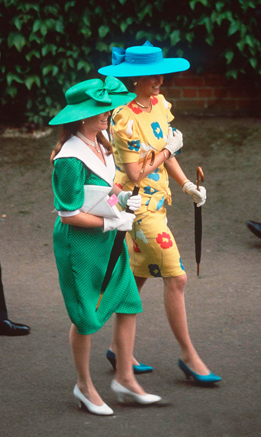 The royal friends put their best fashion feet forward for day two, with Diana dazzling in yellow floral print paired with teal hat and pumps, and the Duchess of York looking wonderful in green and white. The two carried umbrellas, just in case!