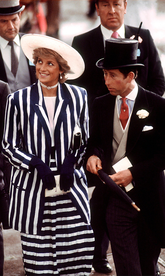 Princess Diana oozed cool in a black-and-white striped suit by <strong>Roland Klein</strong> and a white hat crafted by <strong>Philip Somerville</strong>. She was joined by Prince Charles, who looked dapper as ever in a black morning suit.