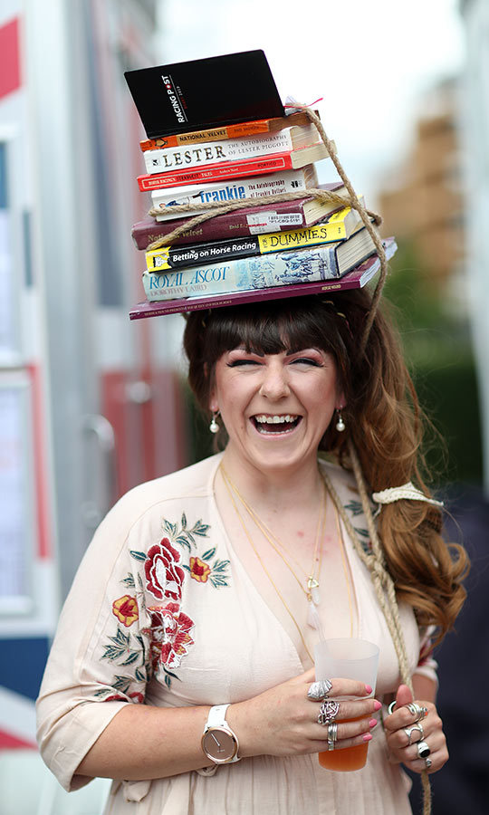 This racing fan stepped out with an appropriate selection of books on her head for Day 3 in 2019!