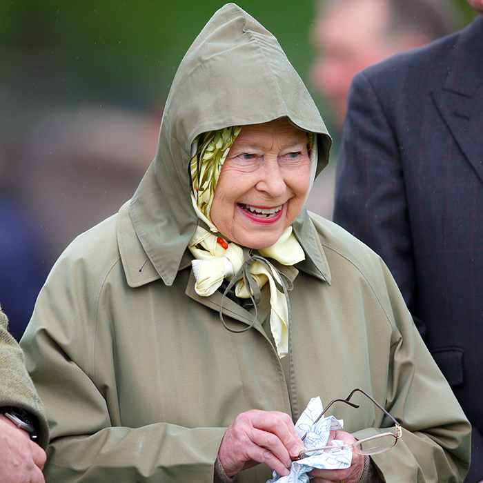 Her Majesty wiped the rain from her glasses while watching one of her horses compete at the Royal Windsor Horse Show in 2013.