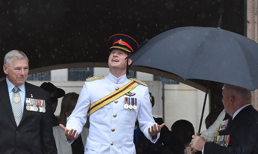 Prince Harry, looking smart in military gear, looked quite surprised by the downpour after laying a wreath at the Australian War Memorial in Canberra in 2015.