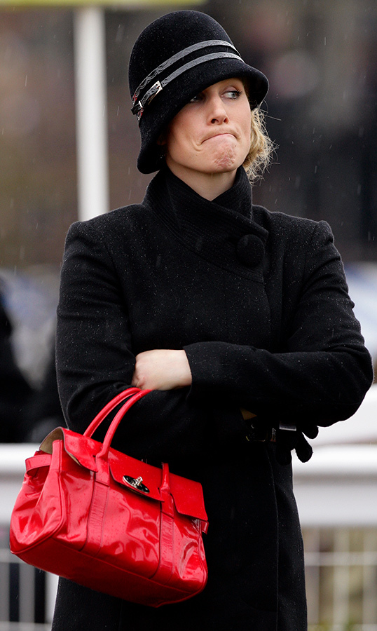 Zara Tindall (then Phillips) wasn't too happy about the rain! She pulled a face while watching the Cheltenham Gold Cup contenders parade in 2010.