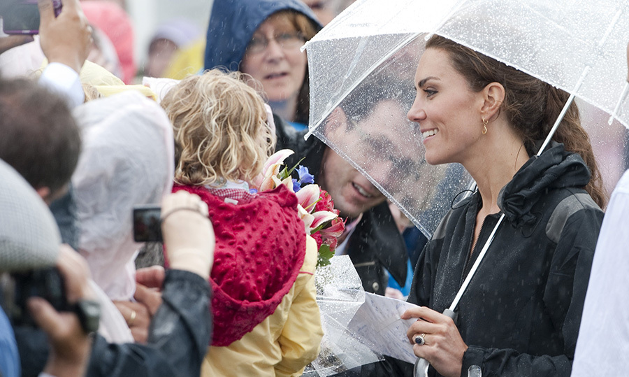 A little rain never stopped Kate from meeting her well-wishers! The Duchess of Cambridge greeted a little girl while visiting Dalvay by the Sea, Prince Edward Island, in 2011.
