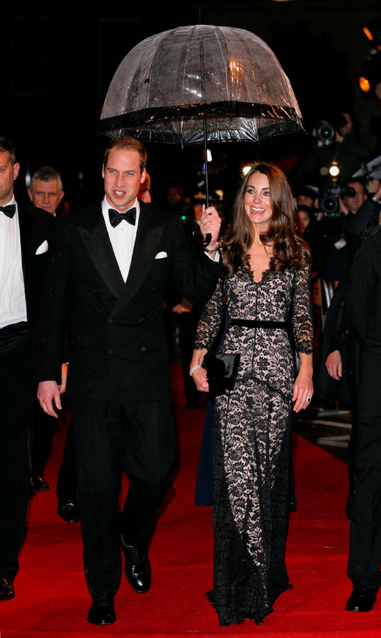 What a gentleman! Prince William held an umbrella over he and Duchess Kate's heads as they attended the UK premiere of <em>War Horse</em> at the Odeon Leicester Square in 2012.