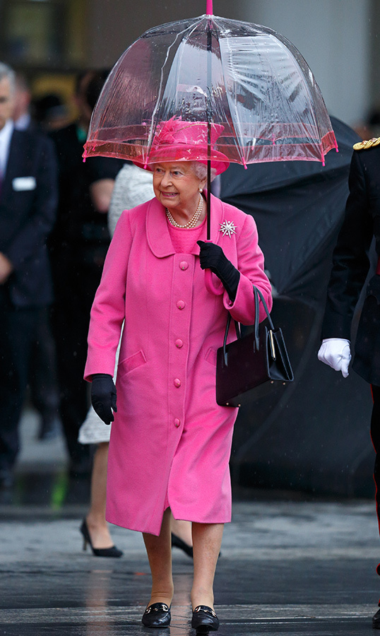 Rain or shine, the Queen never leaves her fashion sense at home! She matched her umbrella to her pink coat while visiting the newly redeveloped Birmingham New Street Station in 2015.