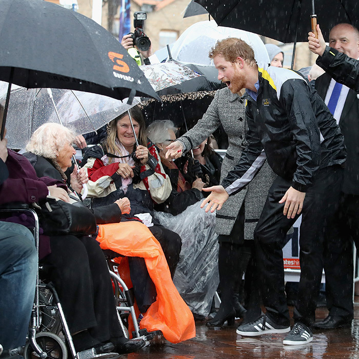 "A drenched Prince Harry was super happy to see old friend 97-year-old <Strong>Daphne Dunne</strong> during a walkabout at the Sydney 2018 <a href=""/tags/0/invictus-games"">Invictus Games</a></strong>.