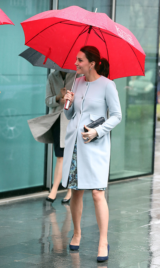 "The Duchess of Cambridge, pregnant with <a href=""/tags/0/prince-louis""><strong>Prince Louis</a></strong>, visited King's College on a rainy day in London in 2018.