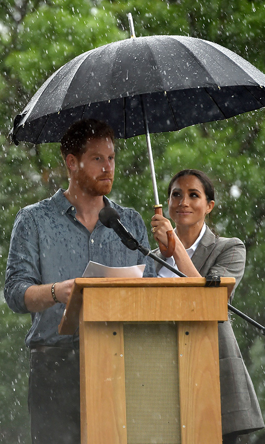 "In one of their sweetest moments to date (and there are many!), <strong><a href=""/tags/0/meghan-markle"">Duchess Meghan</a></strong> held an umbrella for her husband <a href=""/tags/0/prince-harry""><strong>Prince Harry</a></strong> as he addressed a crowd in Dubbo, Australia while on royal tour.