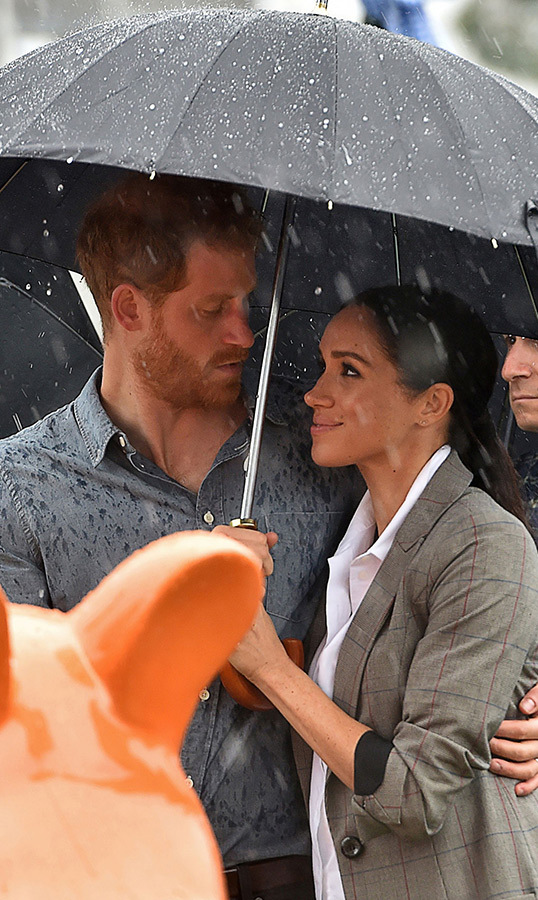 They even shared a tender moment under their umbrella.