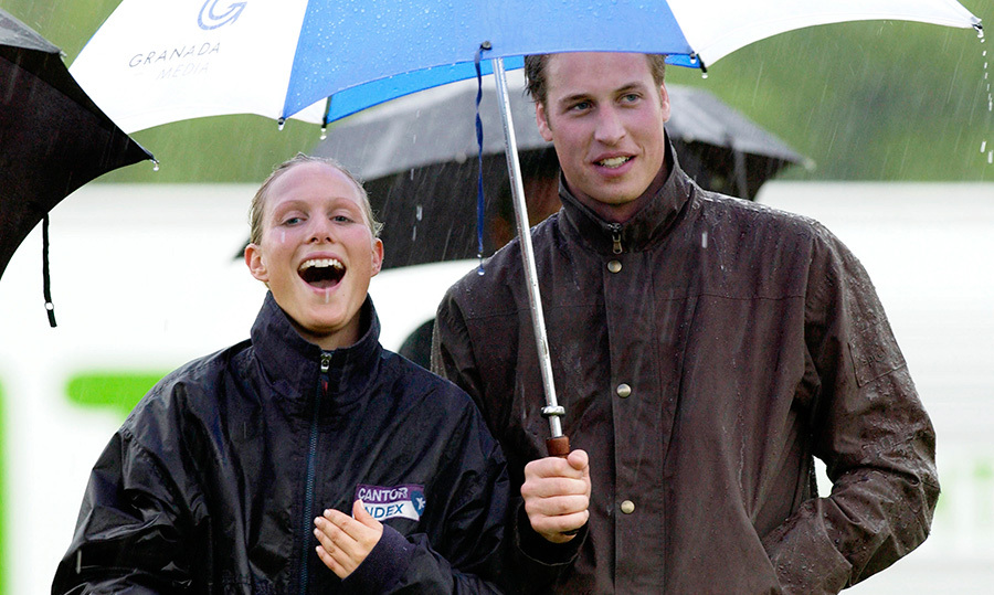 Royal cousins Prince William and Zara Tindall (then Phillips) shared an umbrella during a downpour.