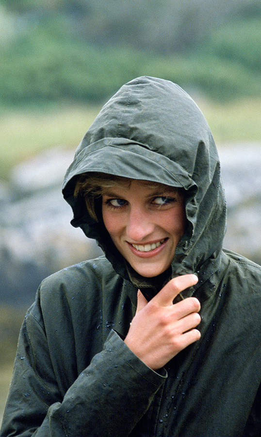 Diana, the late Princess Of Wales, wrapped herself tightly in a raincoat while on the rainy Western Isles of Scotland.