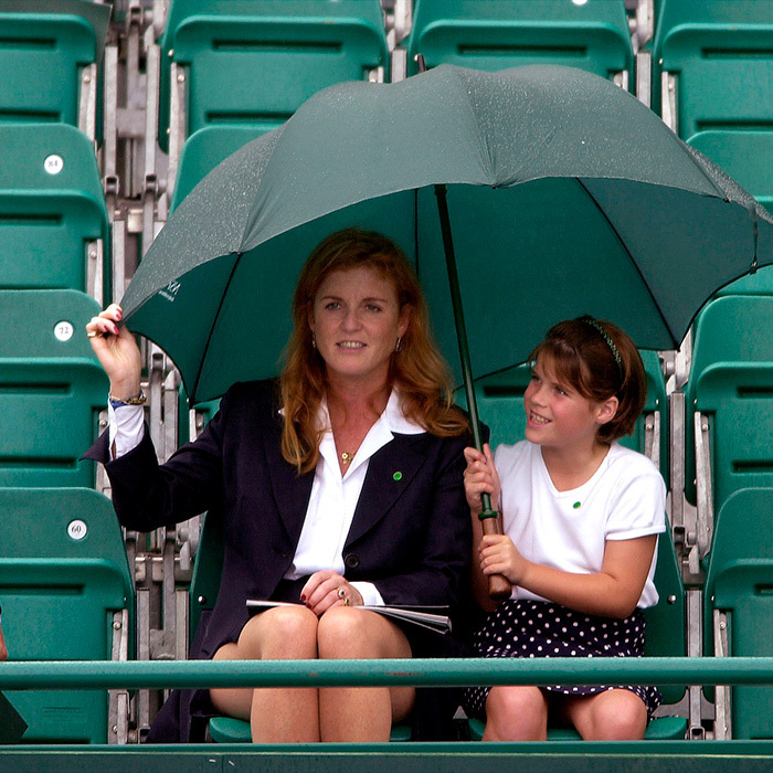 "<a href=""/tags/0/sarah-ferguson""><strong>Sarah, Duchess of York</a></strong>, and a young <strong><a href=""/tags/0/princess-eugenie"">Princess Eugenie</a></strong> huddled under an umbrella together while watching a tennis match at Buckingham Palace.