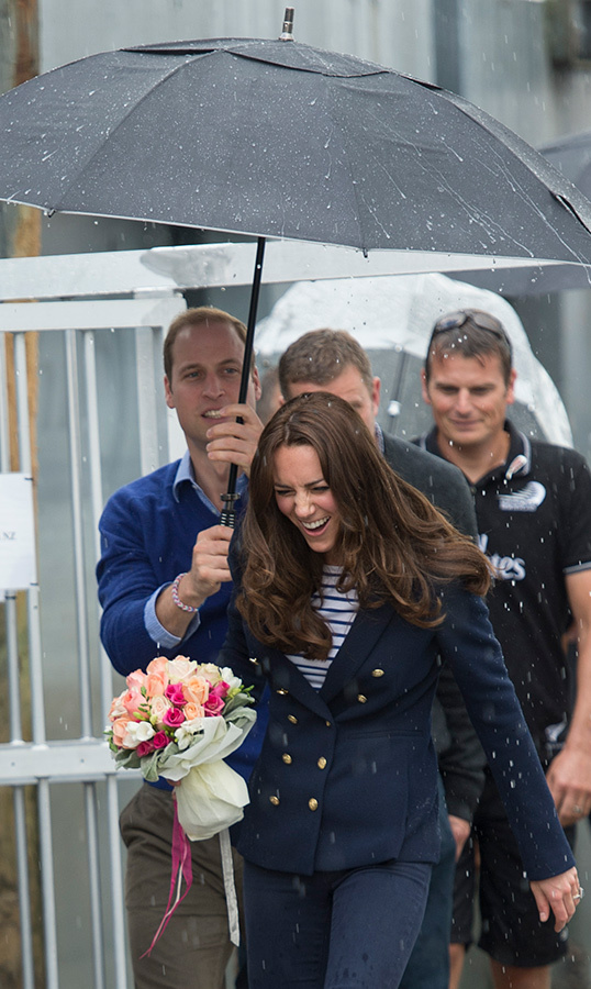 Prince William saved Duchess Kate from the rain while visiting New Zealand in 2014. 