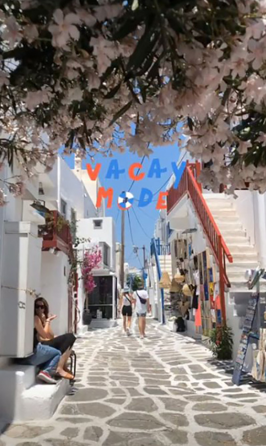 "She shared a photo of the picturesque cobblestone streets and white stucco homes of Greece to her Instagram stories. The photo read: ""vacay mode"".