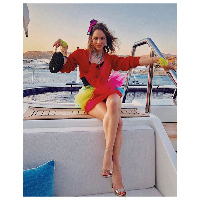 "Katharine looked ready for the '80s! She took some major inspiration from Madonna for her colourful yacht ride. She captioned the snap: ""Honey this is how you throw a party in Mykonos b-tch.""