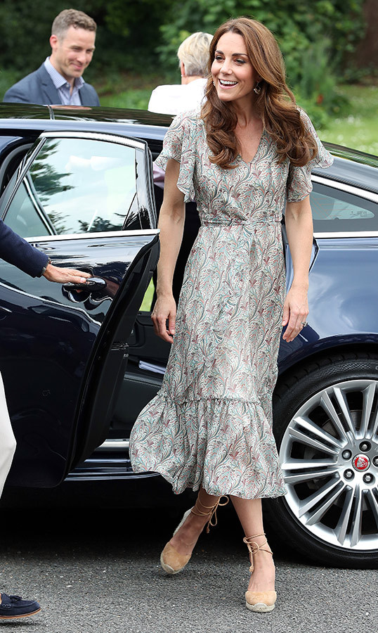Duchess Kate arrived looking beautiful as ever and ready for summertime! Wearing a new patterned dress, Kate anchored her casual yet chic number with a pair of Castañer Carina wedge lace-up espadrilles.