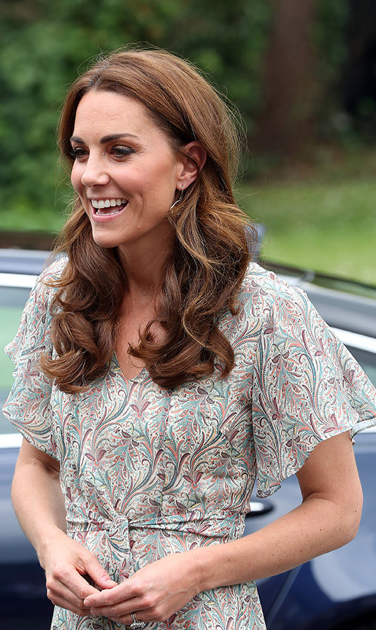 "For the fun day, Kate rocked her sun-kissed hair in bouncy curls. She kept the strands tucked behind her ears, showing off what appear to be her <a href=""https://catherinezoraida.com/products/fern-hoop-earrings""><strong>Catherine Zoraida Fern Hoop</a></strong> earrings. Her makeup look was simple, showing off her natural beauty.