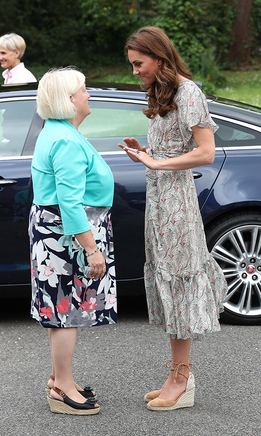 The duchess was greeted by an official as she arrived at Warren Park.