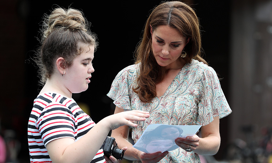 The Duchess of Cambridge took a moment to chat with <strong>Ffion Turner</strong>, looking over a photo the girl took.
