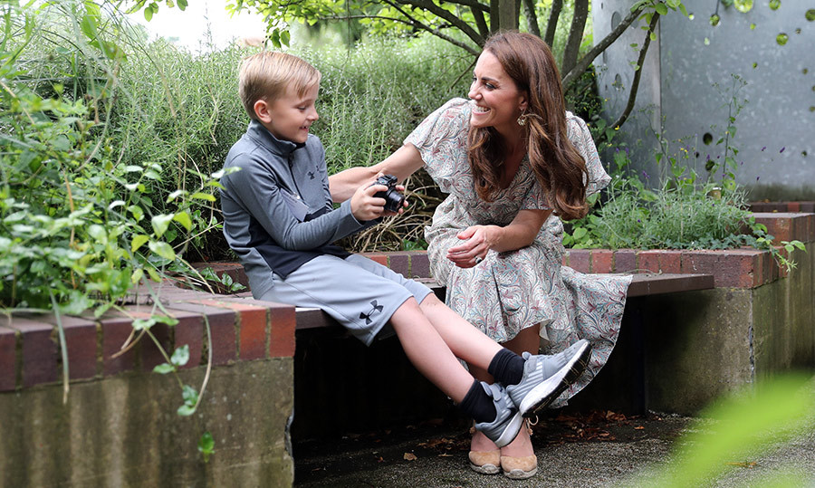 Kate took a particularly liking to one child, <strong>Josh Evans</strong>, as they chatted on a bench.