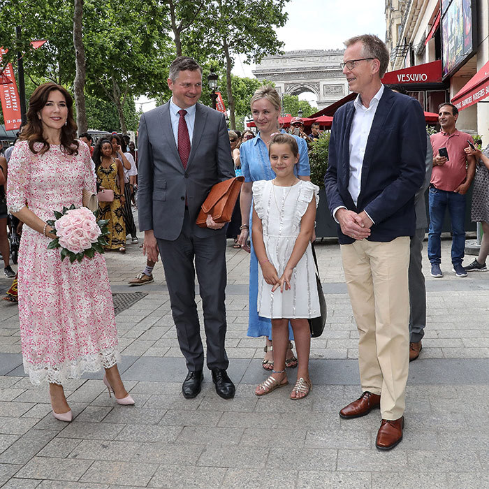 Paris, je t'aime! Crown Princess Mary of Denmark and her family spent the day in France with ambassador of Denmark to France Michael Starbaek Christensen and director of the House of Denmark Torben Nielsen. Mary absolutely dazzled in a white-and-pink dress paired with pale pink pumps.