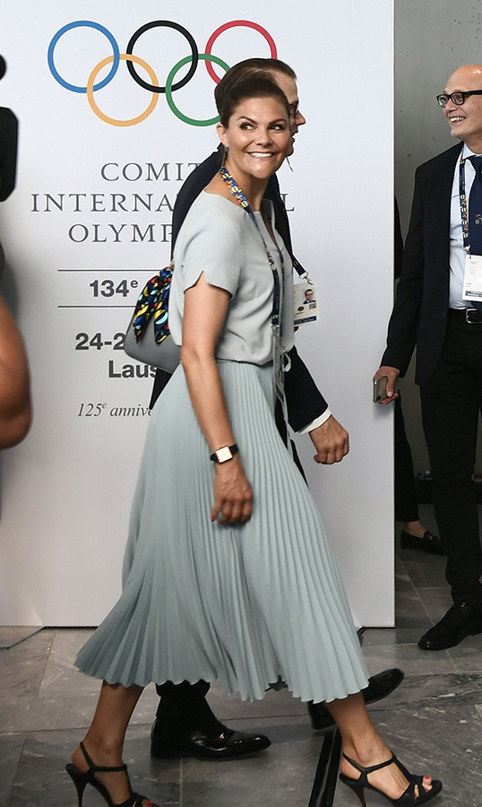 Sweden's Crown Princess Victoria arrived for a session of the International Olympic Committee on June 24, wearing a blue pleated skirt, a matching blouse and strappy heels.
