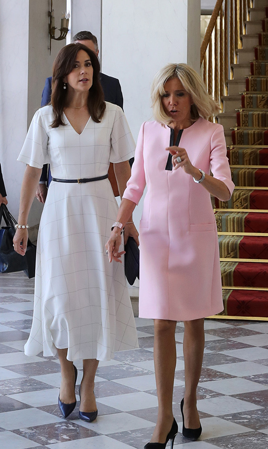 French First Lady Brigitte Macron welcomed Crown Princess Mary at the Elysee Palace. Mary looked beautiful in a floaty black-and-white dress paired with black pumps, while Brigitte stunned in hot pink.