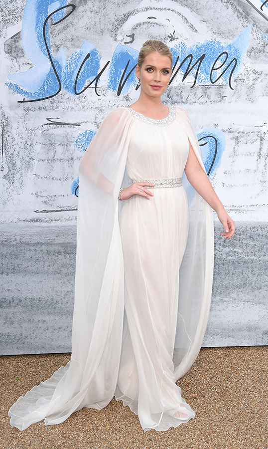 Lady Kitty Spencer was an absolute vision at The Summer Party 2019 presented by Serpentine Galleries and Chanel. She looked ethereal in a white caped gown, cinched in at the waist with a glittering accessory.