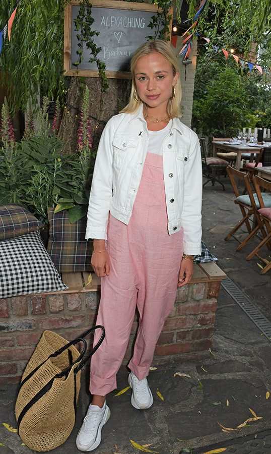 On June 20, for the launch of Barbour by ALEXA CHUNG collection, Lady Amelia Windsor looked sweet in a pink jumpsuit, paired with a white denim jacket, white sneakers and an oversized straw bag.