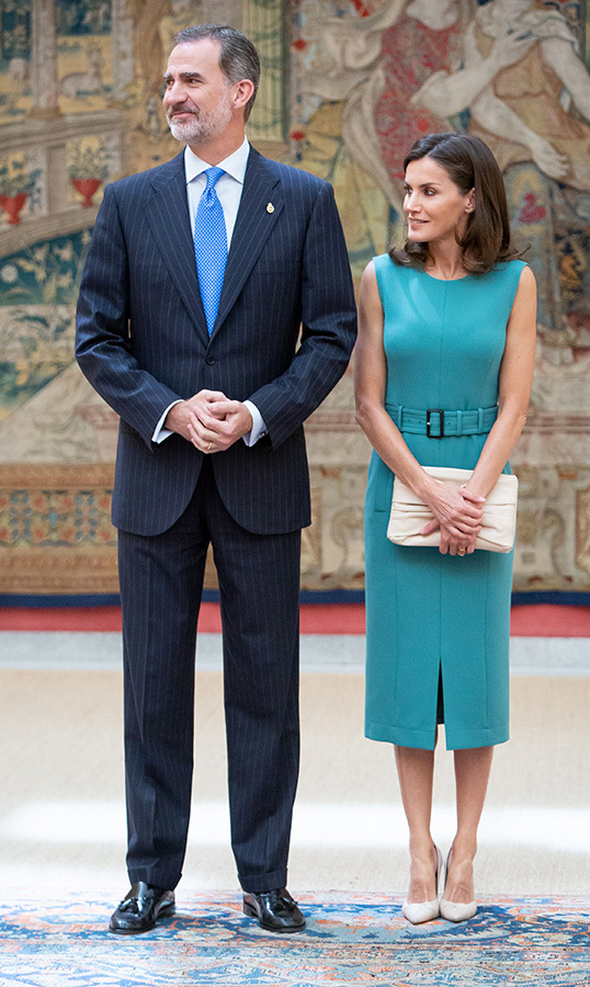Queen Letizia of Spain looked beautiful in a belted teal pencil dress, anchoring the ensemble with white pumps and a matching clutch. She joined her husband, King Felipe VI of Spain, to meet with the members of the Boards of Trustees of the Princess of Asturias Foundation.
