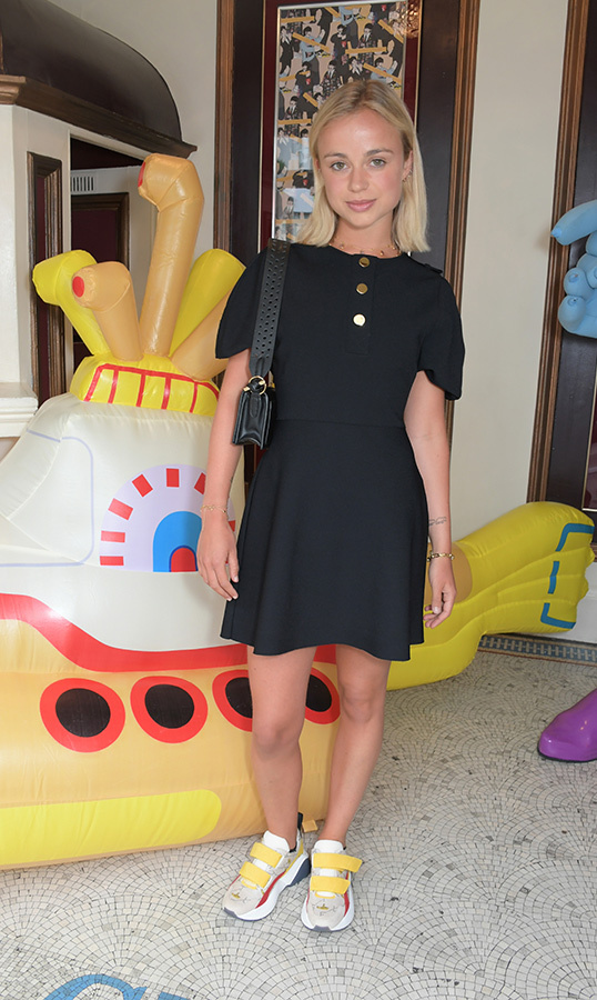 It's summertime for Lady Amelia Windsor! The young royal looked cool as ever for a private screening of <em>Yellow Submarine</em> hosted by Stella McCartney on June 24. She wore a black mini dress and chic sneakers, paired with a small black bag.