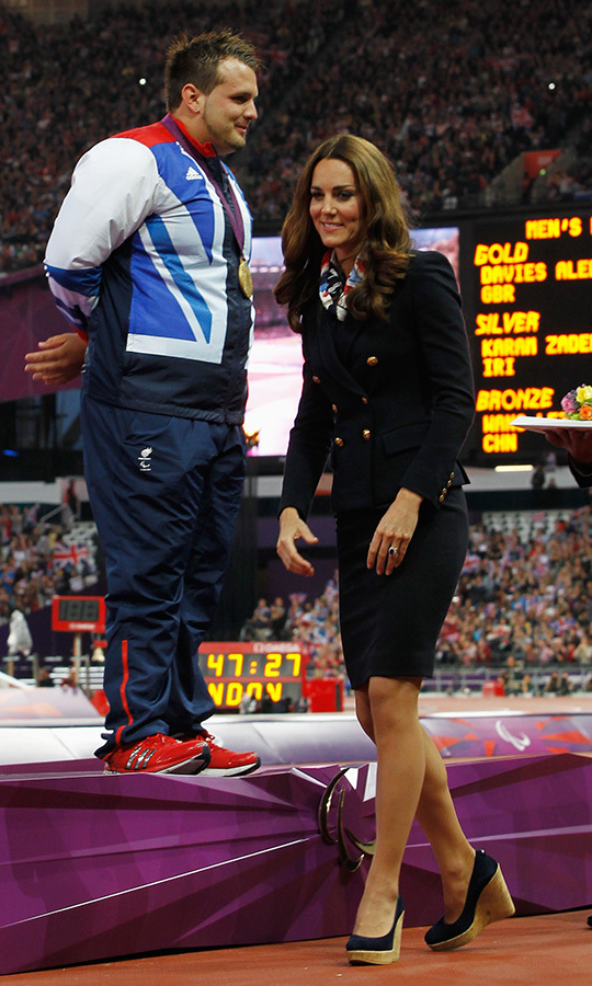 "Kate presented gold medalist Aled Davies with his medal during the ceremony for the Men's Discus Throw. Kate broke out her pair of <a href=""https://www.amazon.com/Stuart-Weitzman-Womens-Corkswoon-Wedge/dp/B00622GSD8"">Stuart Weitzman ""Corkswoon"" wedges</a>.