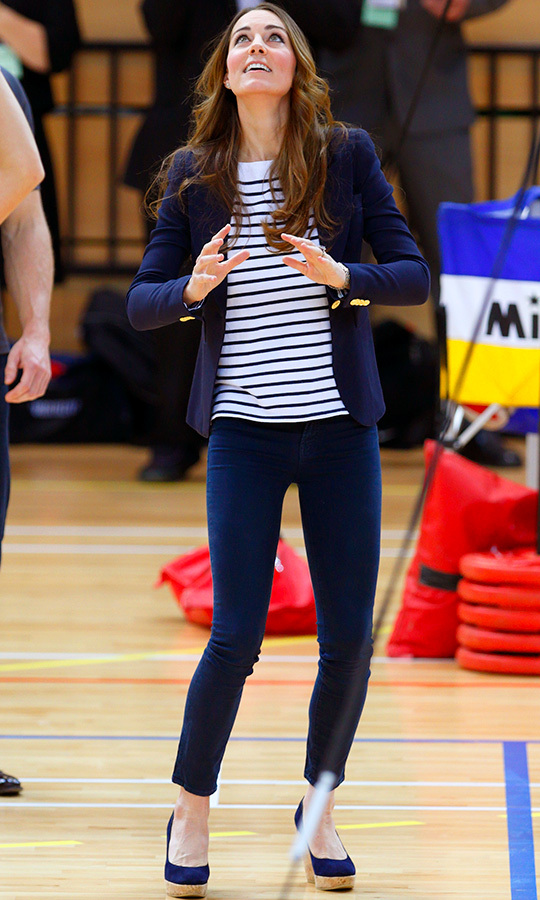 "Kate hit a volleyball during a SportsAid Athlete Workshop  at the Queen Elizabeth Olympic Park in October 2013, looking no further than her Stuart Weitzman ""Corkswoon"" wedges to keep her ankles safe.