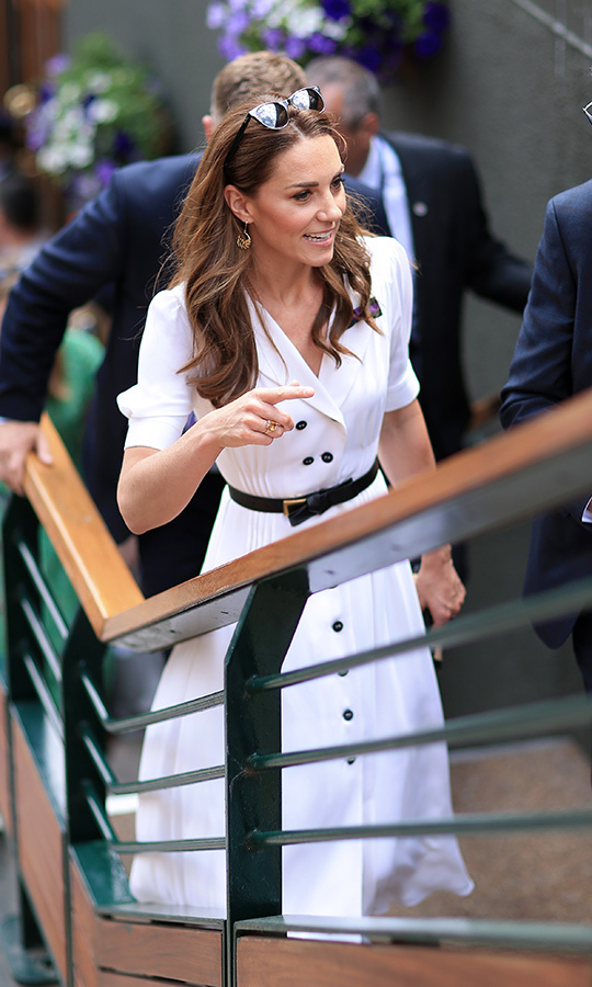 Kate's hair was noticeably sun kissed and tucked behind her ears, showing off her sweet <strong>Catherine Zoraida</strong> Gold Fern Hoop Earrings.
