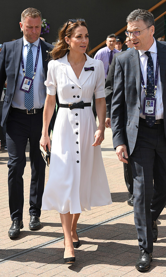 "Duchess Kate arrived looking stunning as ever at day two of Wimbledon. Looking her typical elegant self, she stunned in a white-and-black <strong>Suzannah</strong> dress, her waist accentuated by a black belt by <strong><a href=""/tags/0/alexander-mcqueen"">Alexander McQueen</a></strong>. She paired the look with cat eye <strong><a href=""/tags/0/ray-ban"">Ray Ban</a></strong> sunglasses, carrying a small handbag and black suede pumps.