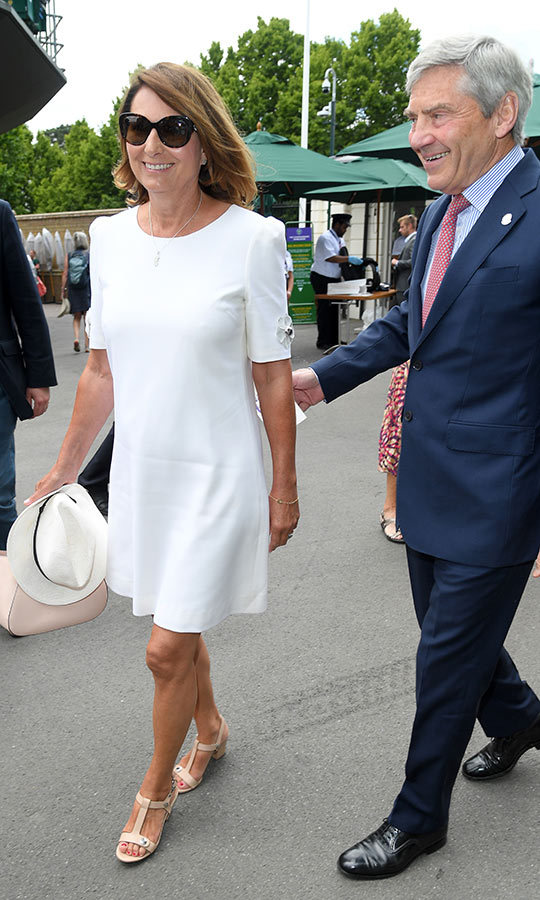 "On July 3, <strong><a href=""/tags/0/kate-middleton"">Duchess Kate</a></strong>'s mom and dad, <strong><A href=""/tags/0/carole-middleton"">Carole</a></strong> and <strong>Michael Middleton</strong>, were all smiles as they arrived at <strong><a href=""/tags/0/wimbledon"">Wimbledon</a></strong> for Day 3 of competition in the championships. 