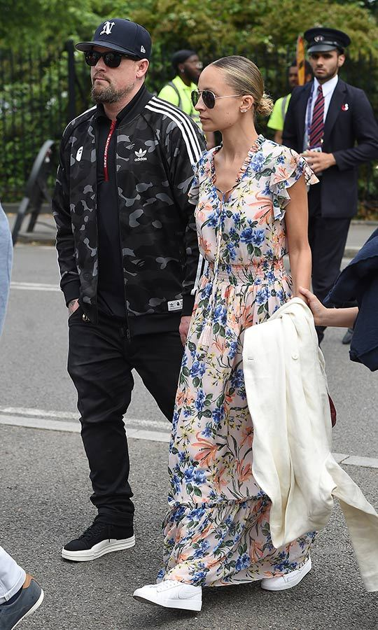 "<strong><a href=""/tags/0/good-charlotte"">Good Charlotte</strong></a> singer <strong><a href=""/tags/0/joel-madden"">Joel Madden</a></strong> and his wife, supermodel <strong><a href=""/tags/0/nicole-richie"">Nicole Richie</a></strong> stepped out looking chic and casual at once. The pop punk vocalist wore a ball cap, Adidas camouflage jacket, black jeans and sneakers, while Nicole sported a gorgeous floral maxi dress and white sneakers. She carried a white blazer.
