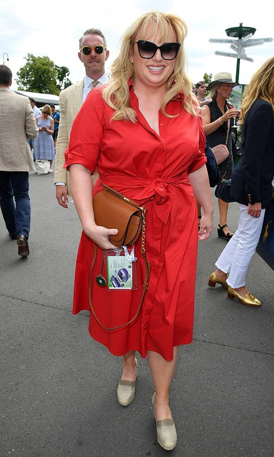 "Australian comedian <strong><a href=""/tags/0/rebel-wilson"">Rebel Wilson</a></strong> looked incredible at Wimbledon on July 8! She sported a red mini dress with an A-line skirt and espadrilles for a day out at the courts, and also rocked cat-eye shades for the event. This was the second time the <i>Cats</i> star has attended the event since it kicked off on July 1. 