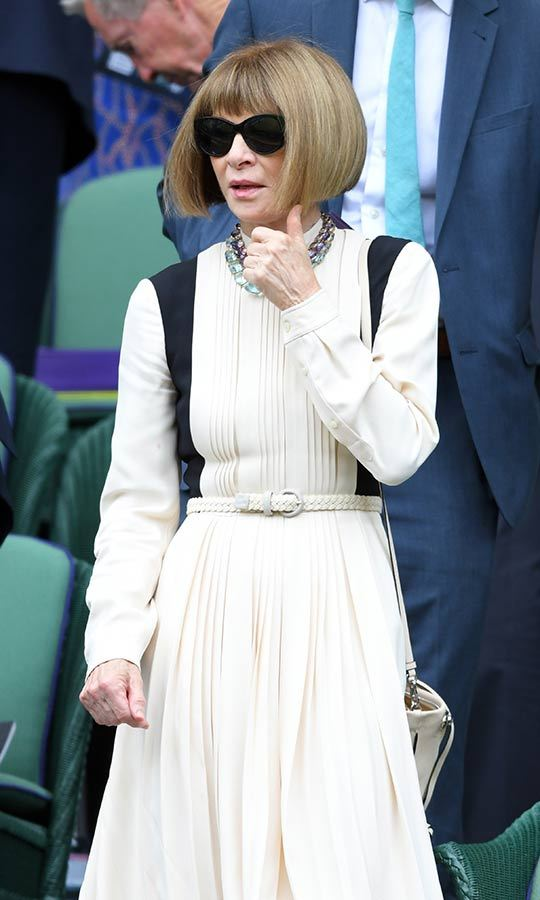 "Style maven <strong><A href=""/tags/0/anna-wintour"">Anna Wintour</a></strong> arrived looking cool and collected in her trademark shades. She sported a pale, pleated dress and gave the thumbs up sign while at her seat. 
