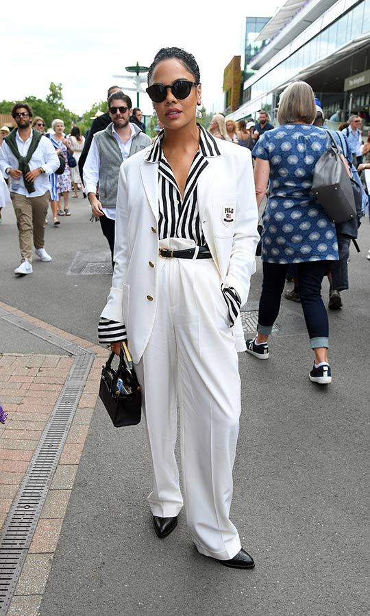 "<i>Avengers: Endgame</i> star <Strong><a href=""/tags/0/tessa-thompson"">Tessa Thompson</a></strong> looked unbelievably stunning at Wimbledon on July 8! She stepped out in a white Polo by Ralph Lauren blazer, matching pants, black flats and a black-and-white pinstriped shirt. She looked effortlessly cool with a black handbag and shades. 