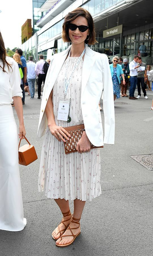 "<i><strong><a href=""/tags/0/outlander"">Outlander</i></a></strong> star <strong><a href=""/tags/0/caitriona-balfe"">Caitriona Balfe</a></strong> looked the picture of stylish as she stepped out to Wimbledon on July 8. The Golden Globe nominated actress wore a white blazer, patterned pleated dress and carried a Polo by Ralph Lauren bag. 