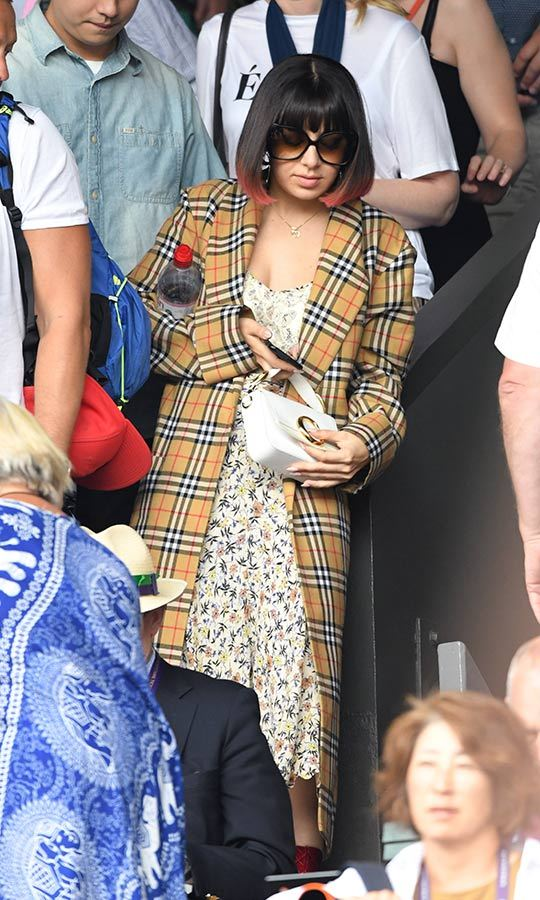 "<strong><a href=""/tags/0/charli-xcx"">Charli XCX</a></strong> stepped out in a floral print dress, which she topped with a clashing tartan print. 