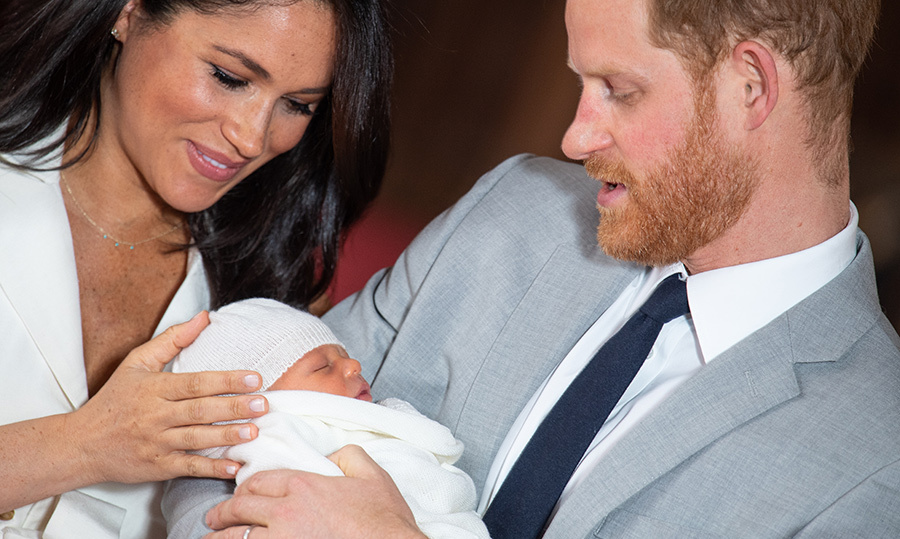 "In one of the first photos ever taken of the Sussex family on May 8, <a href=""/tags/0/meghan-markle""><strong>Duchess Meghan</strong></a> and <a href=""/tags/0/prince-harry""><strong>Prince Harry</strong></a> look down lovingly onto <a href=""/tags/0/archie-harrison""><strong>Archie</strong></a>'s tiny, sleeping face. The two <a href=""https://ca.hellomagazine.com/royalty/02019050850886/prince-harry-meghan-markle-royal-baby-windsor-debut/2""><strong>debuted their bundle of joy</strong></a> at Windsor Castle on May 8, in lieu of the traditional Lindo Wing appearance the day of a royal child's birth.