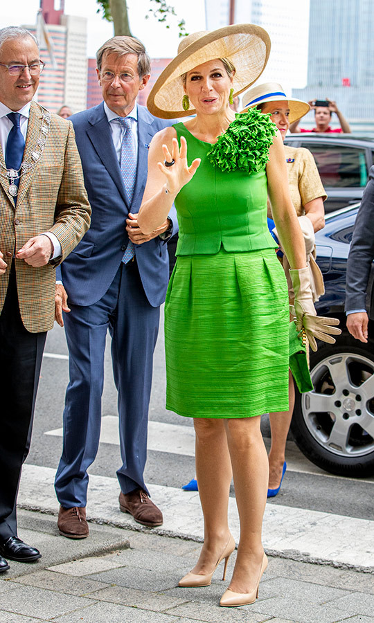 "Aside from her stunning hats, <a href=""/tags/0/queen-maxima""><strong>Queen Máxima</strong></a> is known for her love of bright colours! While opening the Superstraat children exhibition in the Wereld Museum on July 3, the monarch wore a bright dress skirt and blouse combo, paired with a beige wide-brimmed hat and matching patent pumps.