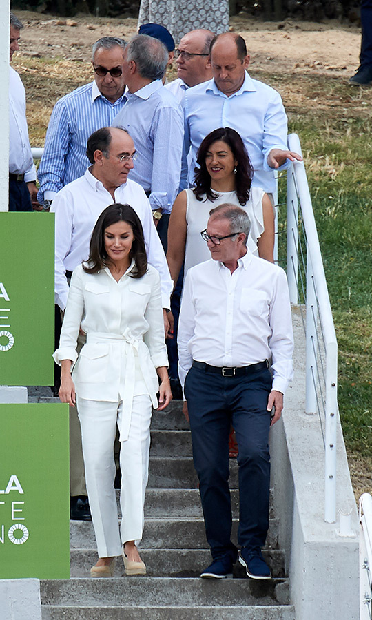 "For a sporty day out to watch the training of the Rugby 7 female national team on July 4, <a href=""/tags/0/queen-letizia""><strong>Queen Letizia</strong></a> wore chic Carolina Herrera linen separates – straight-leg trousers and a belted cargo top. She anchored the white ensemble with Mint & Rose 'Sardinia' espadrille wedges, accessorizing with her beloved Chanel 'Comete' earrings.