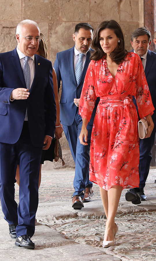 "Radiant in red on July 5 for a seminar, <a href=""/tags/0/queen-letizia""><strong>Queen Letizia</strong></a> dazzled in a recycled Adolfo Dominguez floral print dress, paired with her Magrit 'Ivy' clutch and her 'Ivonne' pumps by the same designer. On her finger, she wore her Karen Hallam gold-plated signature ring, which she wore a few days prior.